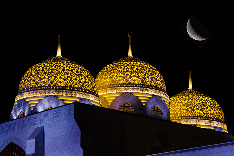 Moon over mosque in Oman